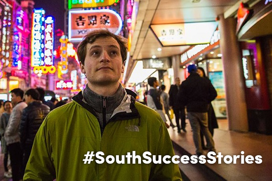 Drew Yates' College of Engineering degree from USA has become his ticket to see the world. Here, he's taking in the sights of Shanghai, China, where he and his co-workers from Prism Systems, Inc., were developing software for a theme park.
